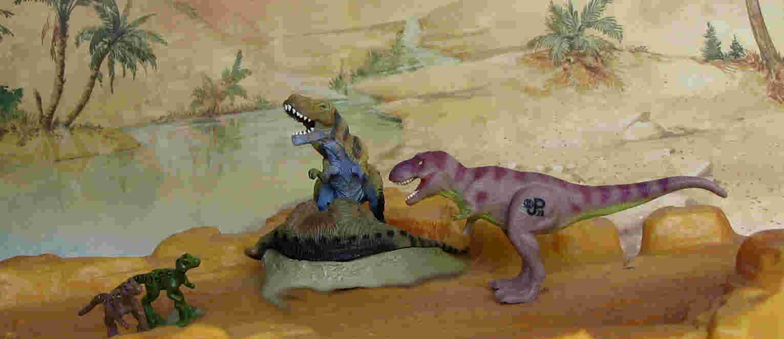 Bandai Tyrannosaurus with lambosaurine carcass. The two chicks are from a JP figure set some of which were also included with the action figures. The adult JP Tyrannosaurus from a mini playset.